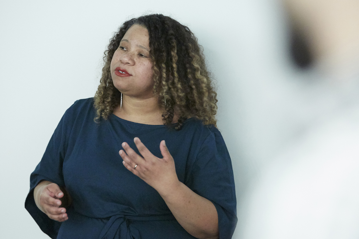 Photo of Senior Curator Crystal Mowry speaking at a recent tour event
