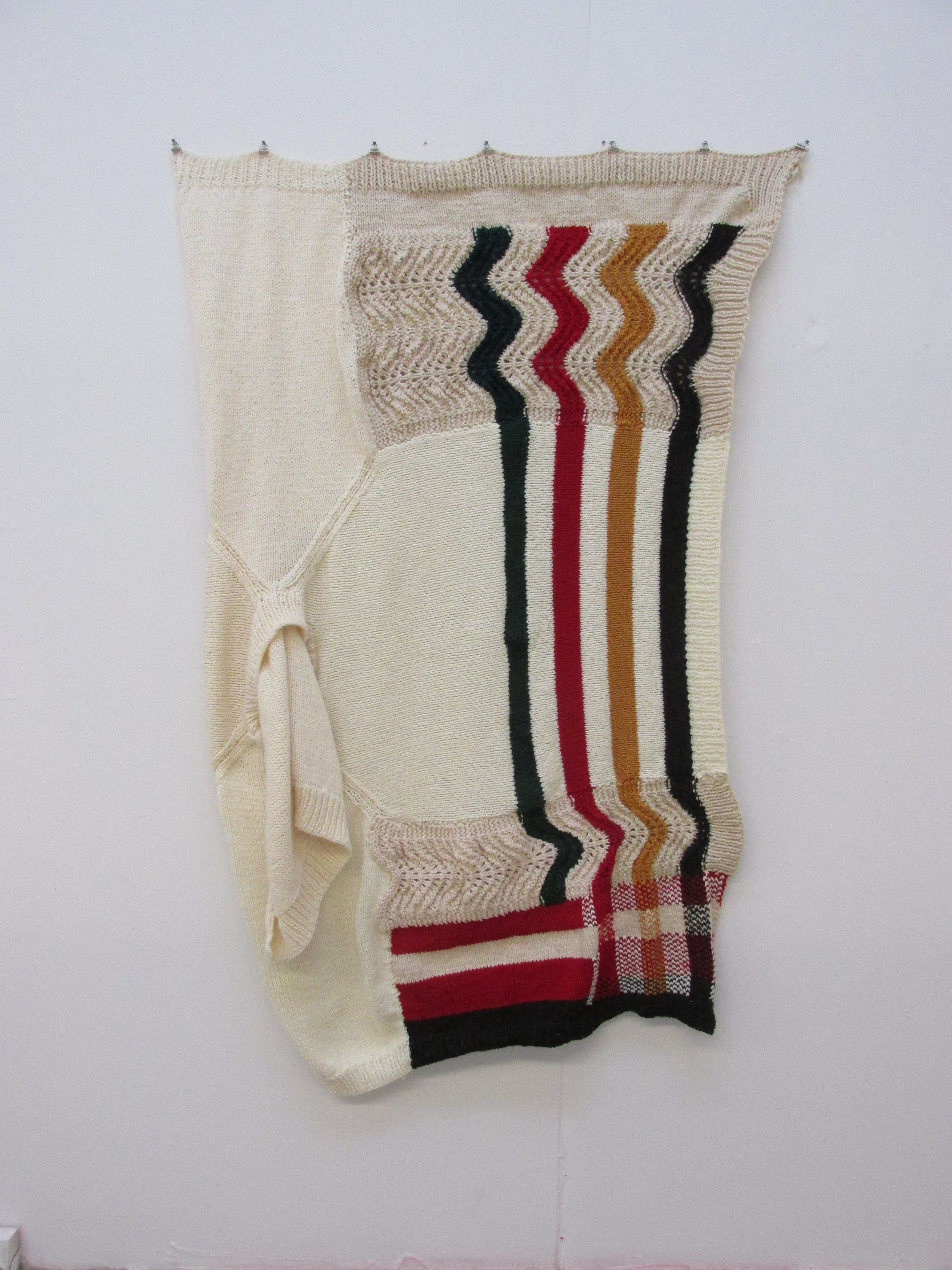 An abstract knitted blanket with irregular Hudson Bay Company stripes by Kate Carder-Thompson