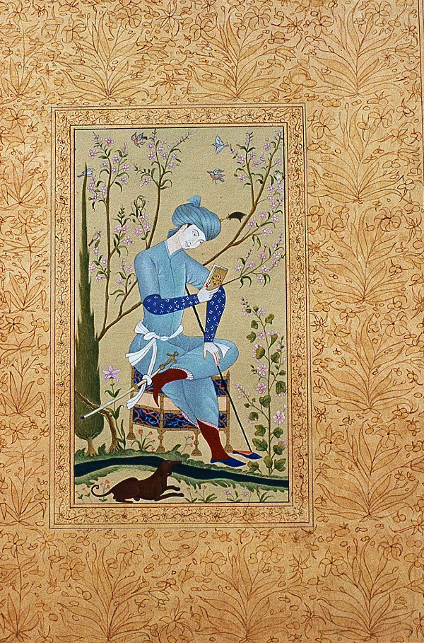 Painting of a young man in blue costume seated in a garden reading a book, depicted in an ornate gold framework drawing by Sumaira Tazeen