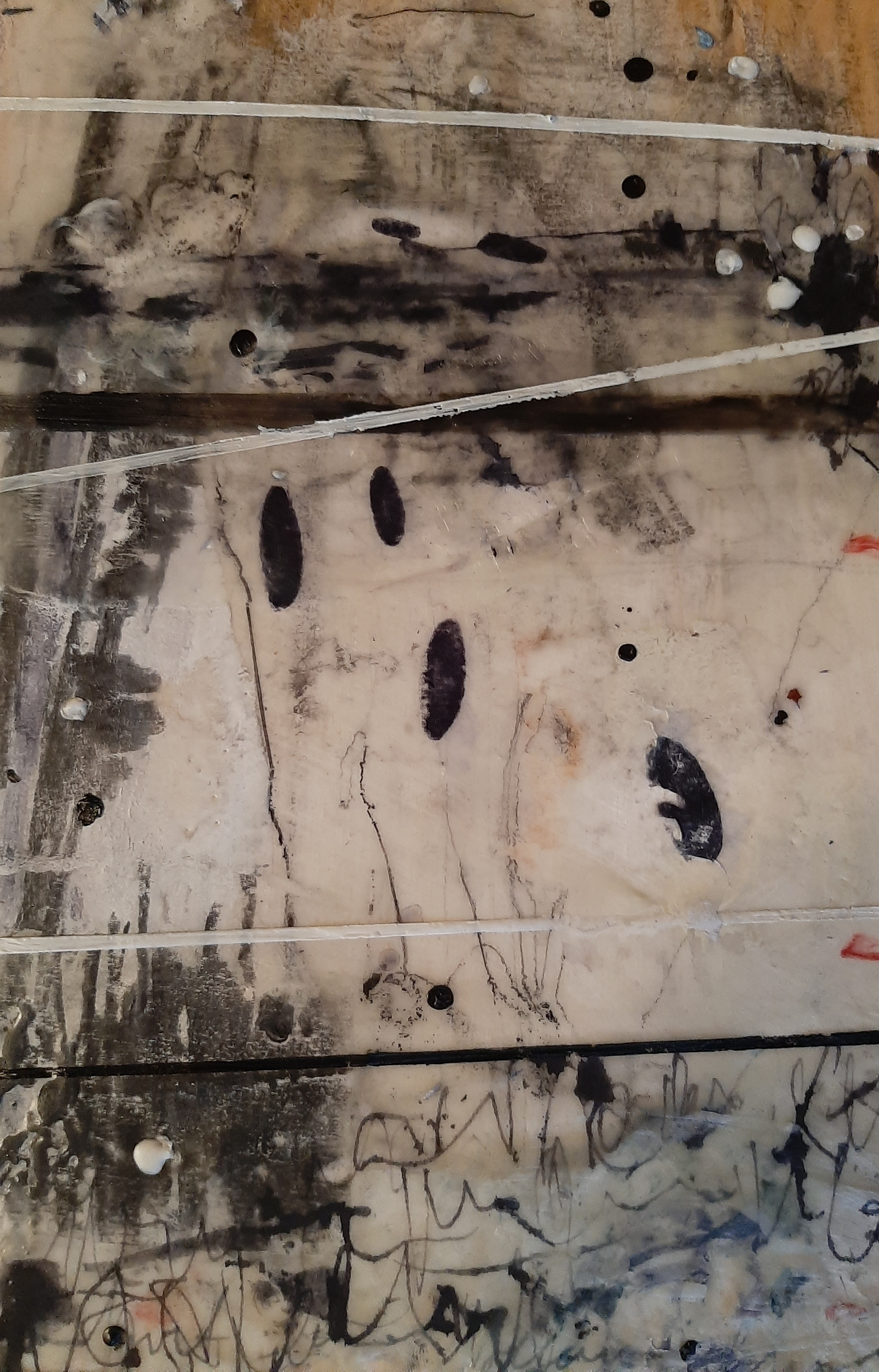 Detail of an abstract encaustic painting in shades of white, grey and black