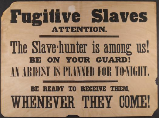 An archival poster reading Fugitive Slaves Attention. The Slave-hunter is among us! Be on your Guard! An Arrest is planned for To-Night. Be Ready to receive them, whenever they come!
