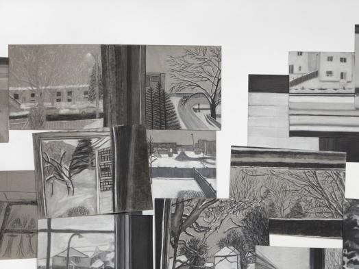 A close-up view of a layered installation of greyscale conte drawings showing views of winter landscapes from windows