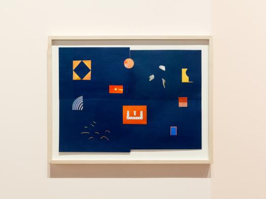 Maggie Groat`s Alternative Guide to SET, a framed paper collage of brightly coloured shapes sparsely arranged on a deep blue background assembled from four pieces of paper